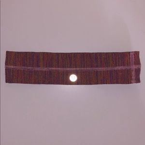 Pink, purple, and yellow Lululemon headband